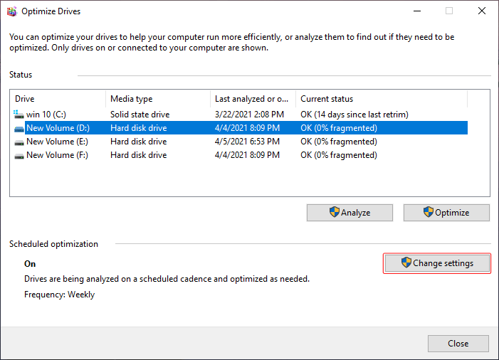 """In the """"Optimize Drives"""" window you will find the option to """"Change settings"""""""
